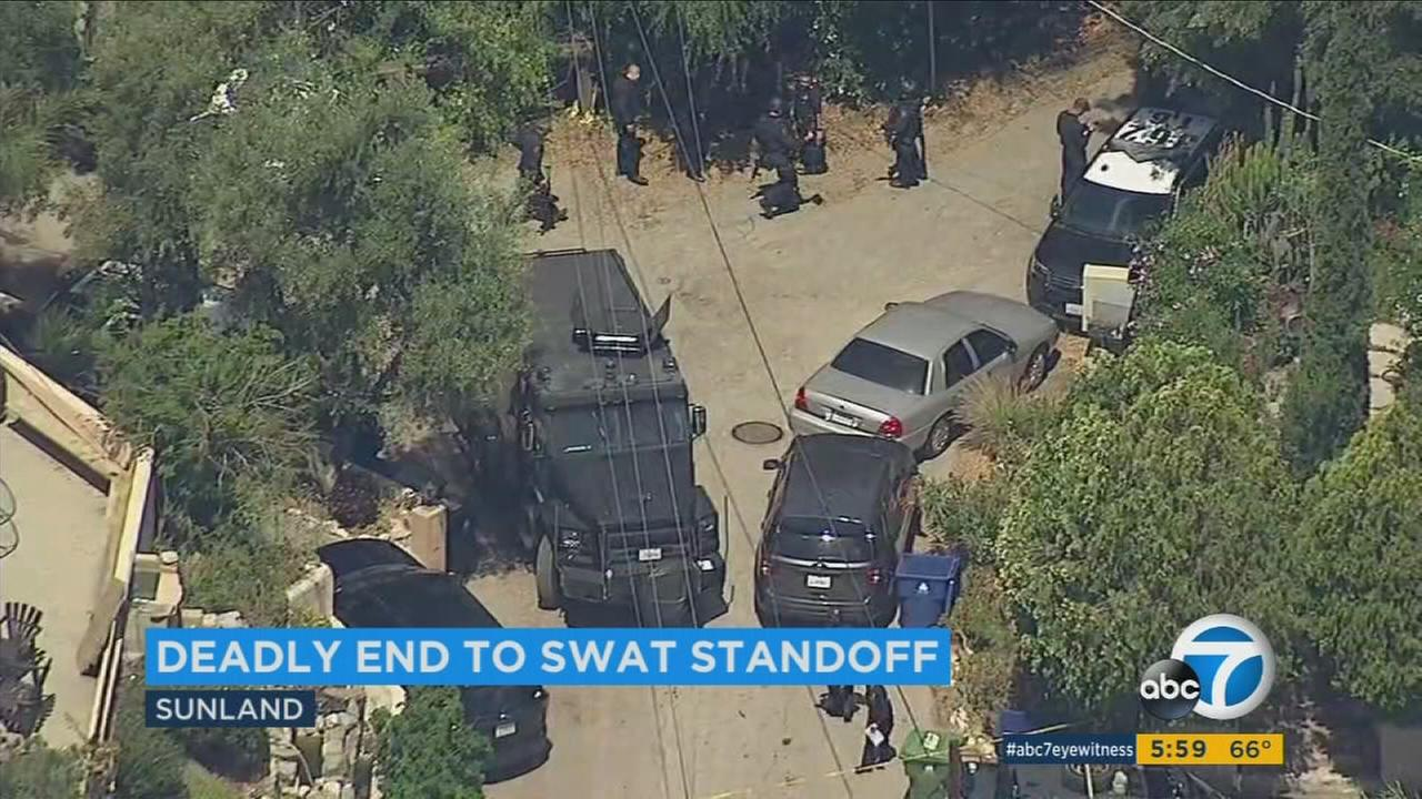 A prowler who broke into a Sunland-Tujunga home died after a dramatic standoff with SWAT officers.