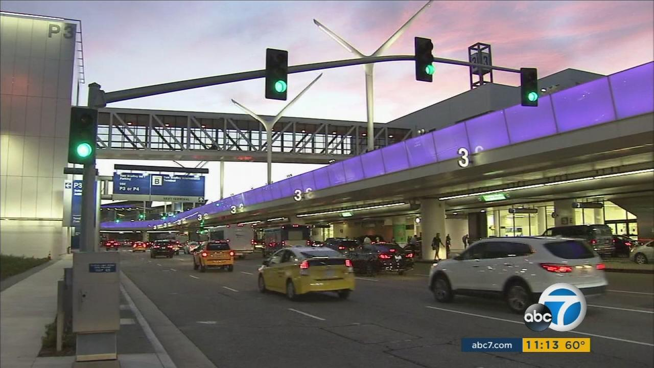 Cars travel through terminals at Los Angeles International Airport during a major terminal shuffle on Tuesday, May 17, 2017.