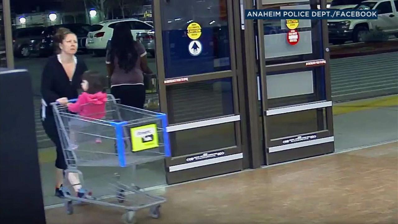 A woman suspected of stealing checks from a Marines mailbox at his apartment complex in Anaheim is shown at a Walmart.