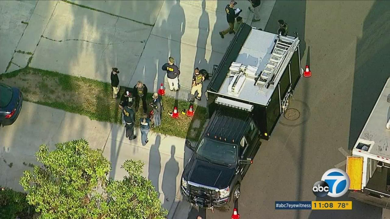 FBI officials join local law enforcement during a large raid operation in Orange and Los Angeles counties on Tuesday, May 23, 2017.