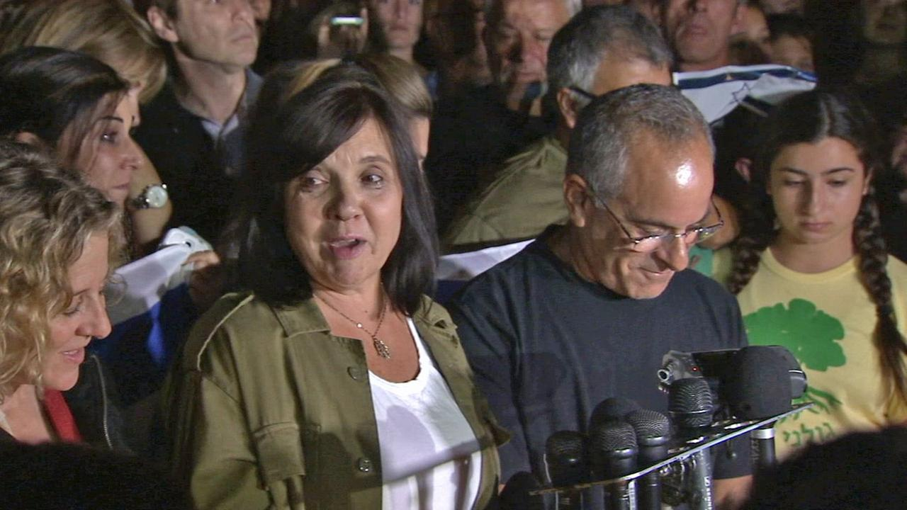 Evelyn and Stuart Steinberg speak at a vigil for their son, Max, an Israeli soldier who was killed in the Gaza Strip on Sunday, July 20, 2014.