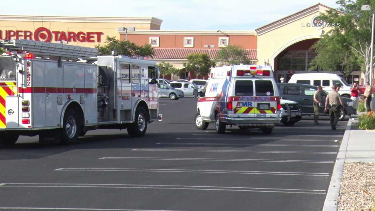 Emergency personnel are seen outside a Target in Apple Valley, where a man was shot on Monday, May 29, 2017.