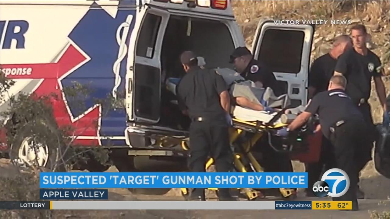 Emergency officials place a suspected gunman, who was injured in a deputy-involved shooting, in an ambulance on on Tuesday, May 30, 2017.