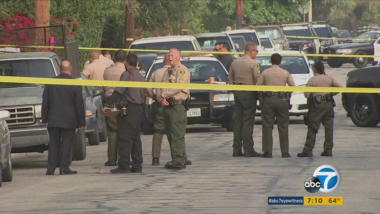 Los Angeles County sheriffs deputies investigate a scene where a juvenile was found shot to death Sunday, June 4, 2017.
