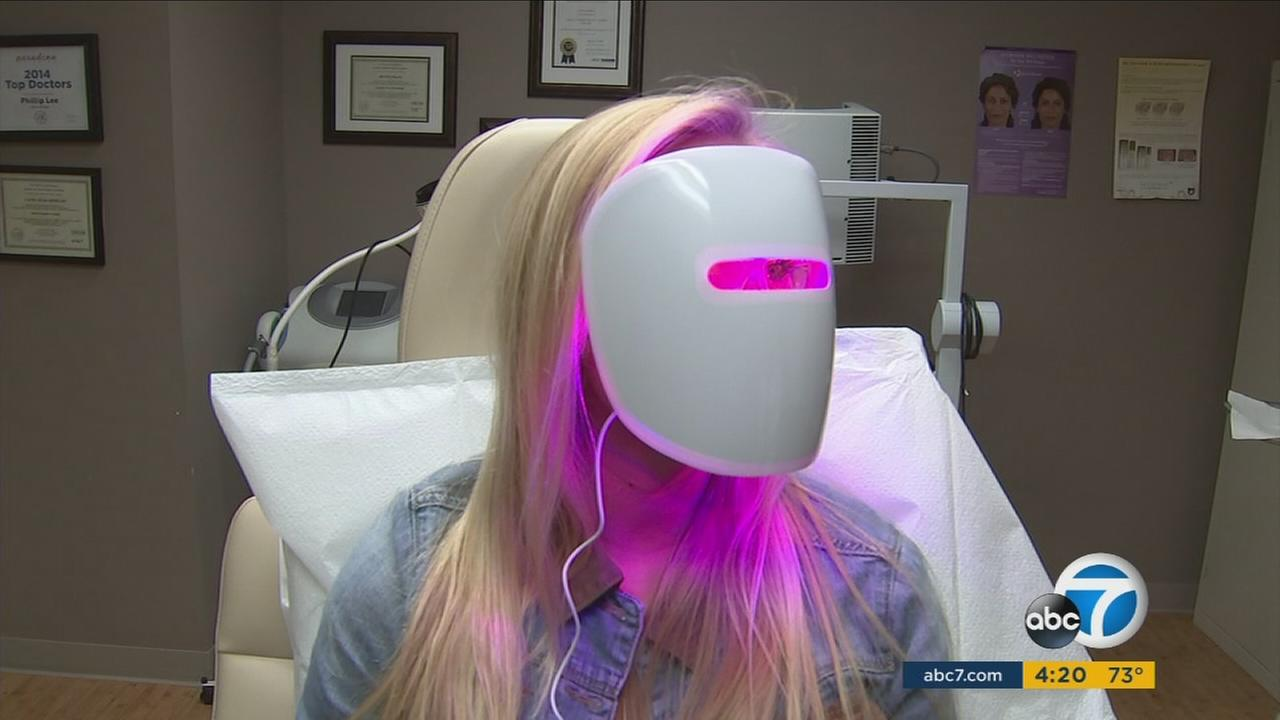 Masks that use red or blue light to treat acne are now available for home use.
