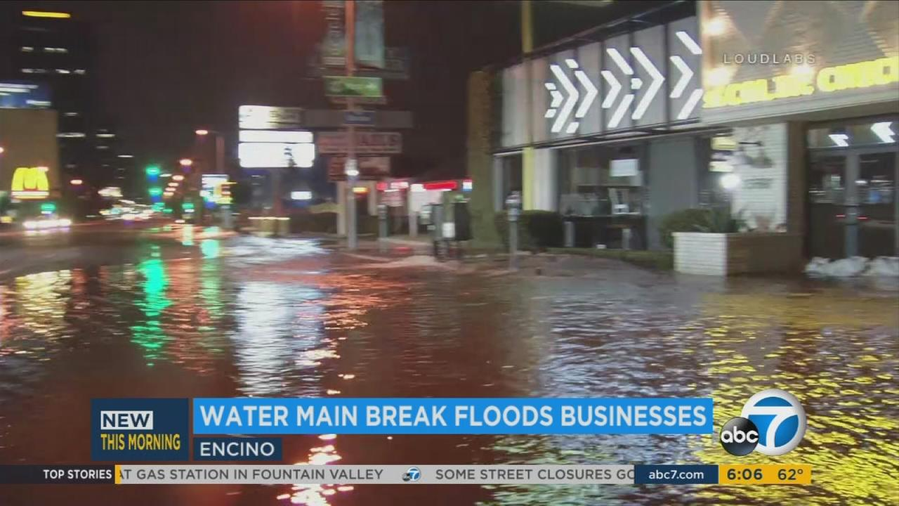 Several businesses in Encino were flooded by a water main break that left a massive wet mess in the area Thursday morning.
