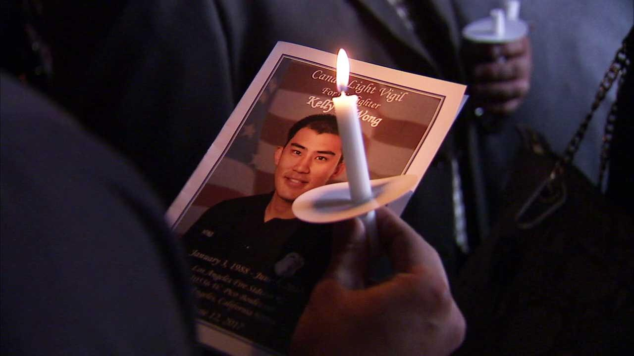 Firefighter Kelly Wongs photo is seen on a program for a vigil held in his honor on Monday, June 12, 2107.