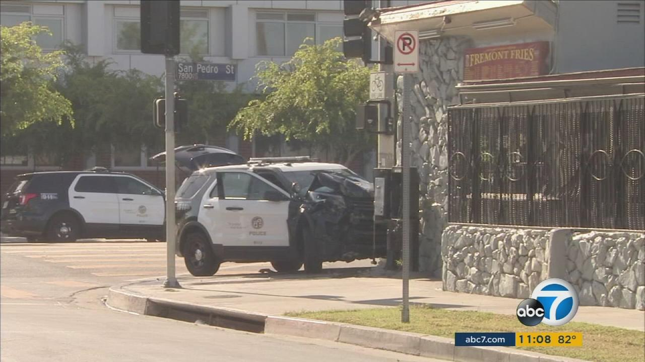 Two Los Angeles police cars were stolen in South Los Angeles, leading to two separate pursuits that ended with crashes and three juvenile suspects in custody, police said.