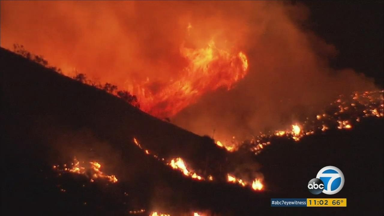 Flames lapped at dry brush and were seen across Castaic Lake on Saturday, June 17, 2017.