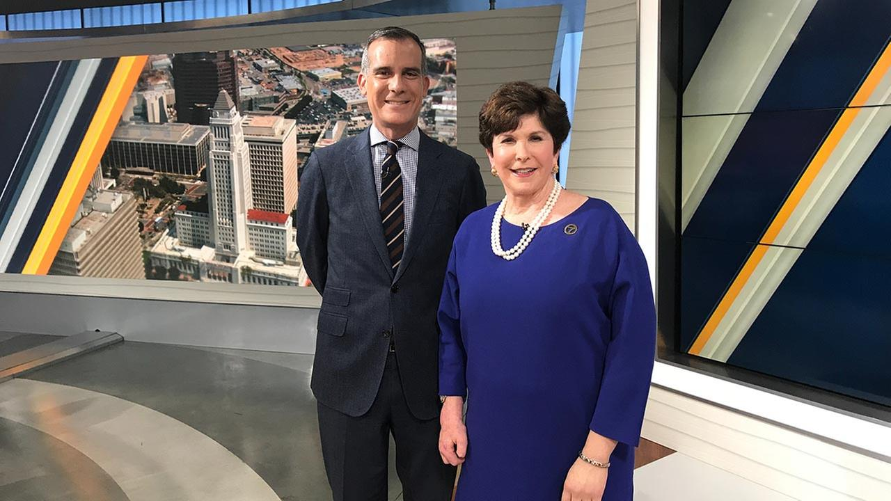 Los Angeles Mayor Eric Garcetti poses for a photo with Adrienne Alpert.