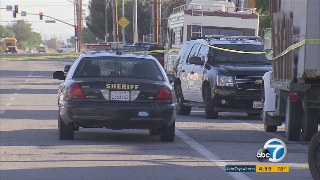 Authorities surround an area in Palmdale after an officer-involved shooting occurred, leaving a teenager and pit bull dead on Thursday, June 22, 2017.