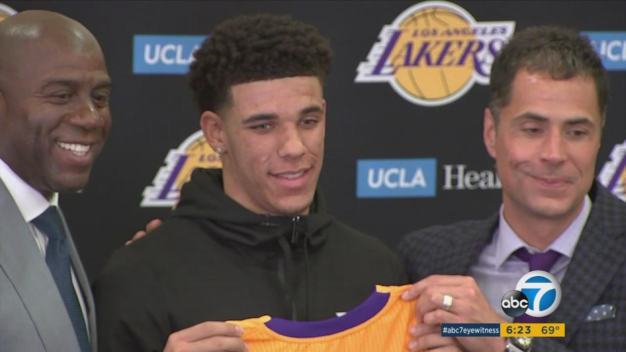 Lakers president of basketball operations Magic Johnson and GM Rob Pelinka introduce draft pick Lonzo Ball at a press conference in El Segundo on June 23, 2017.