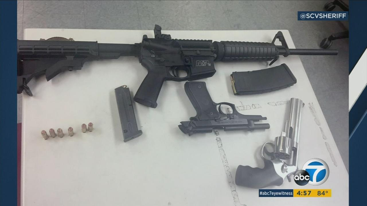 Police arrested three teens after finding them with loaded weapons they claimed were part of a birthday prank.