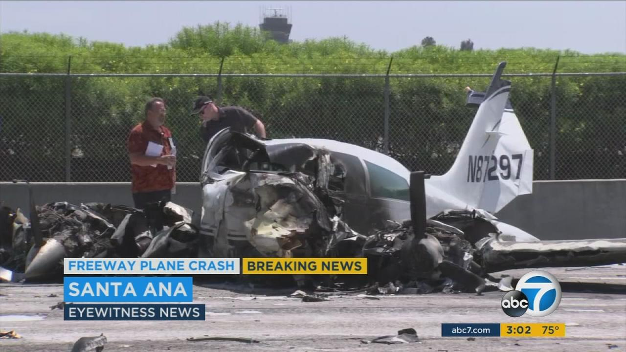Two people were injured after a small airplane crashed on the 405 Freeway near John Wayne Airport in Orange County on Friday, officials said.
