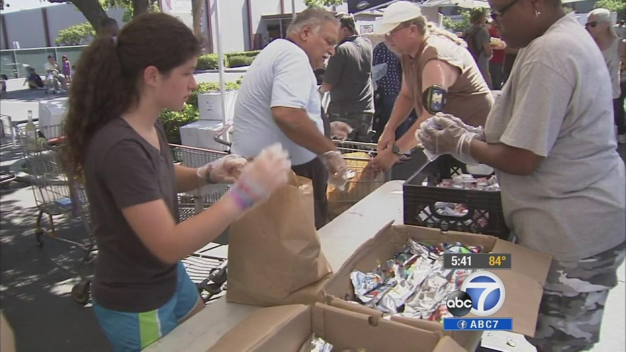 Volunteers at Vineyard Church of Anaheim provide donations to people in need on Thursday, July 24, 2014.