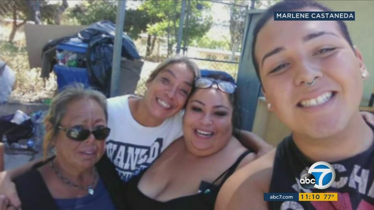 Olga Martinez, 58, is shown in a photo with family members. She is in the far left corner of the photo.