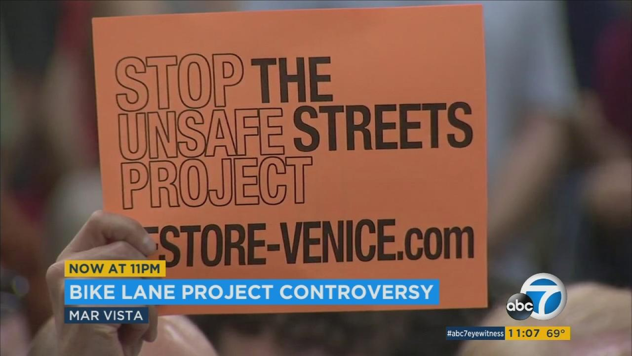 Mar Vista residents held up signs opposing a bike lane widening project going on on Venice Boulevard.