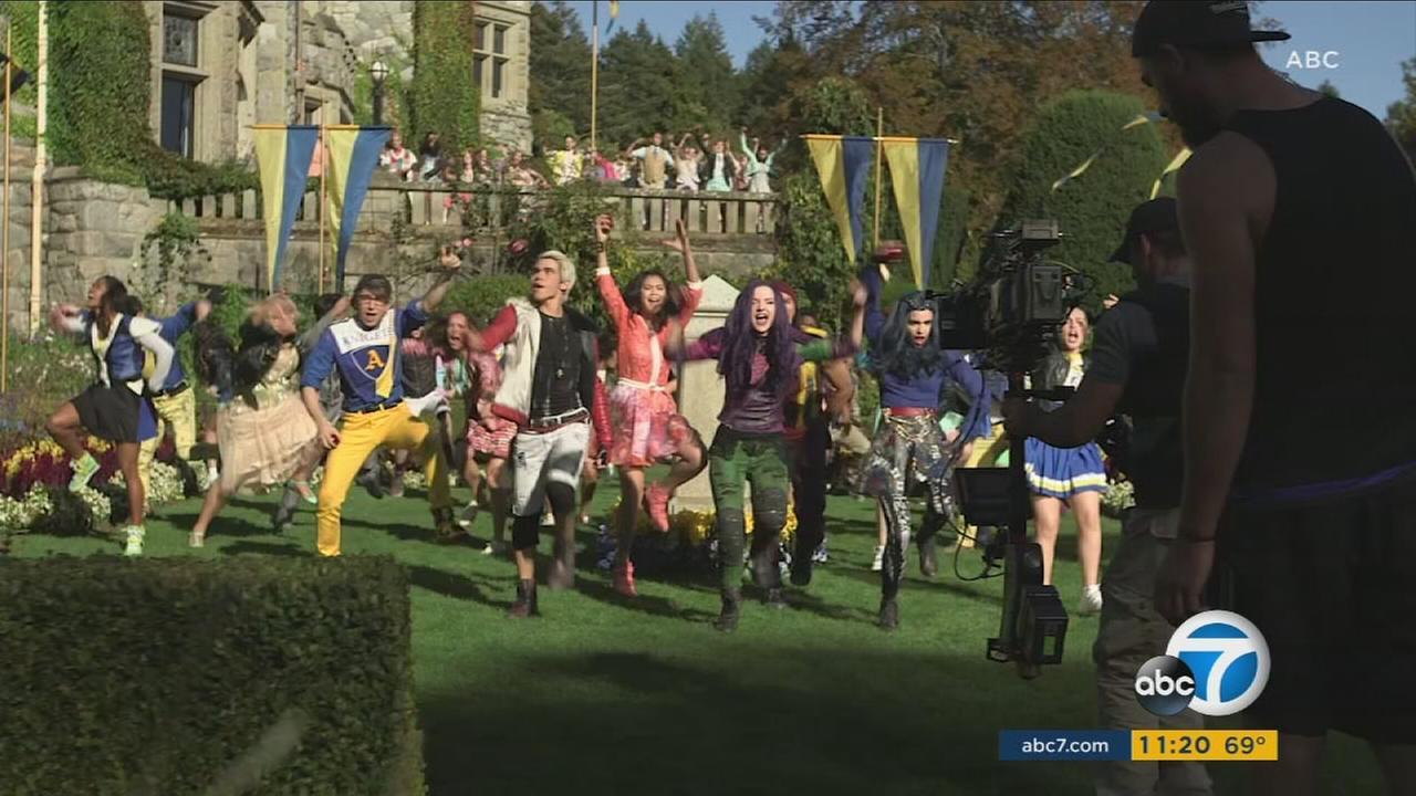 The cast of Descendants 2 are shown during a scene.