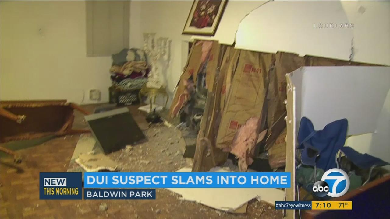 A possible drunk driver is accused of hitting three cars before crashing into the side of a Baldwin Park home while people were asleep.
