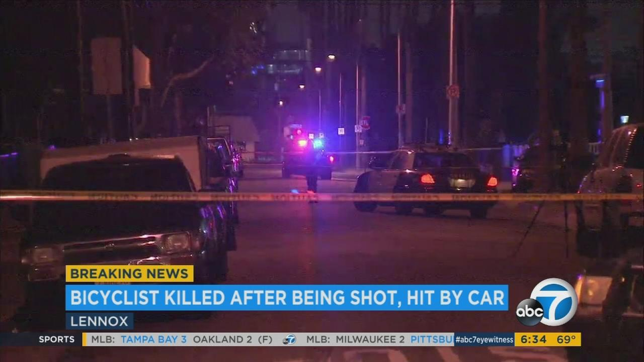 Authorities cordoned off a street after a man riding a bike was hit by a car and then fatally shot in Lennox on Tuesday, July 18, 2017.