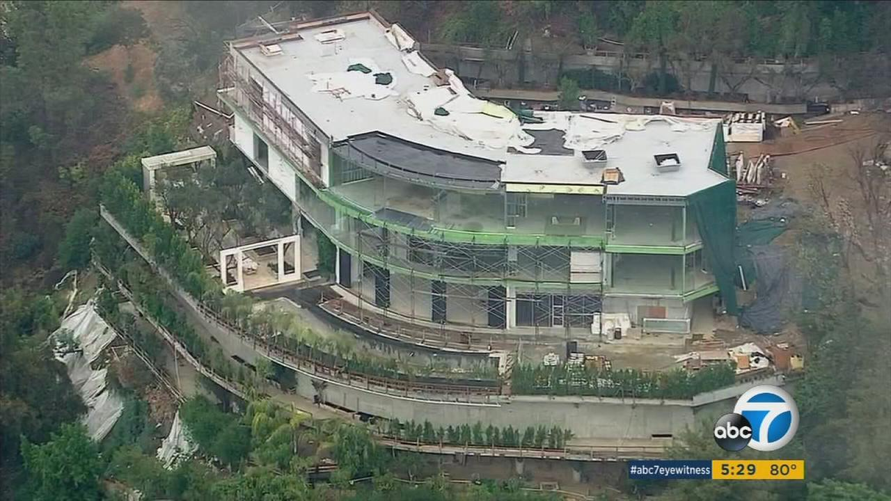 A mega mansion in Bel Air that is unfinished due to a developer illegally building parts of the home.
