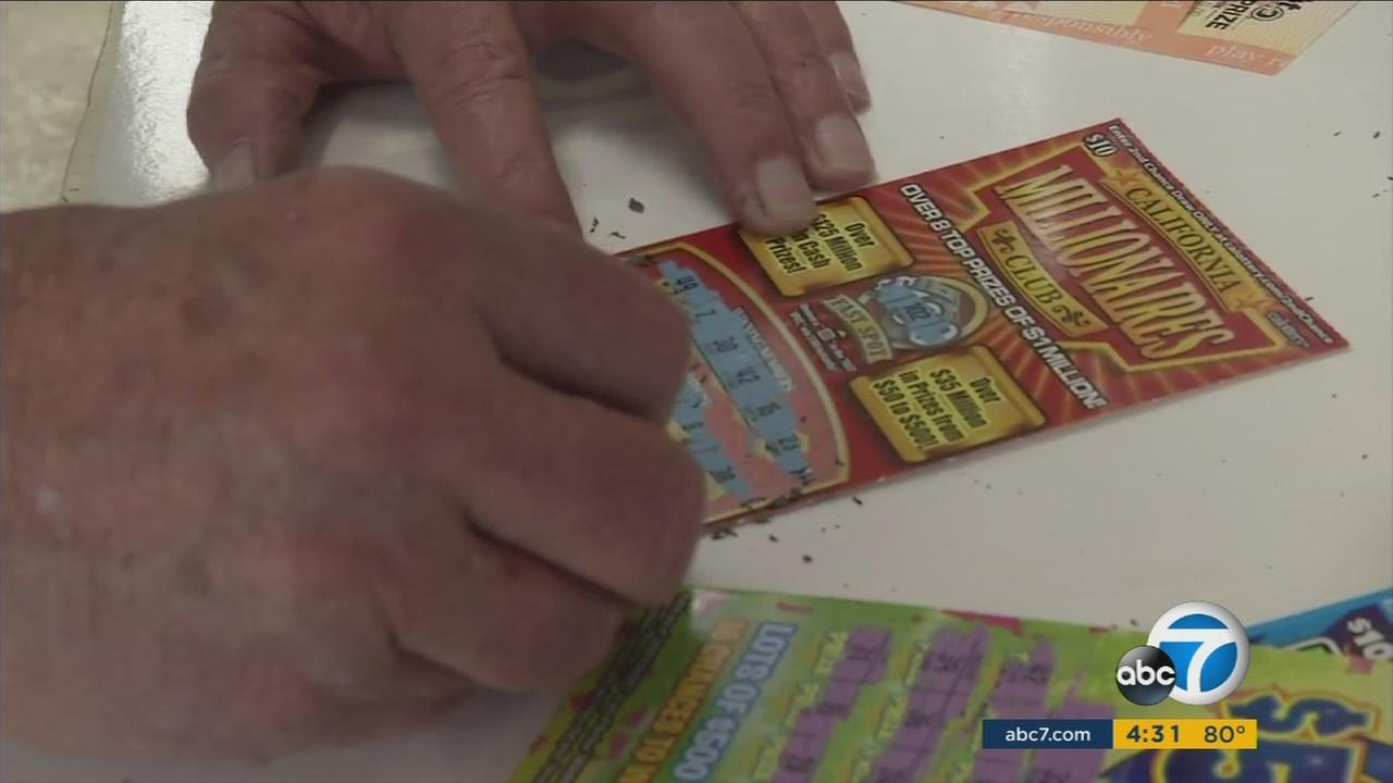 A man is shown using pennies to play Scratchers tickets in California.