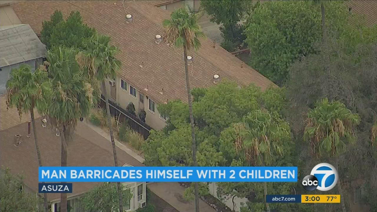 A domestic violence suspect surrendered hours after he barricaded himself and held two children hostage in an Azusa home on Monday, July 24, 2017.