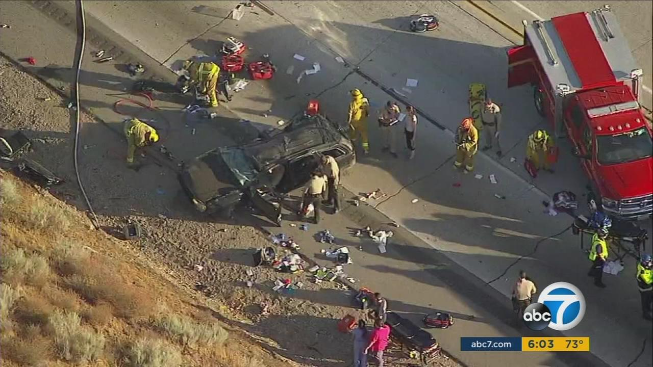 An 8-year-old girl and a 14-year-old boy remained hospitalized in critical condition Monday, days three of their family members were fatally injured in a crash on the 14 Freeway.