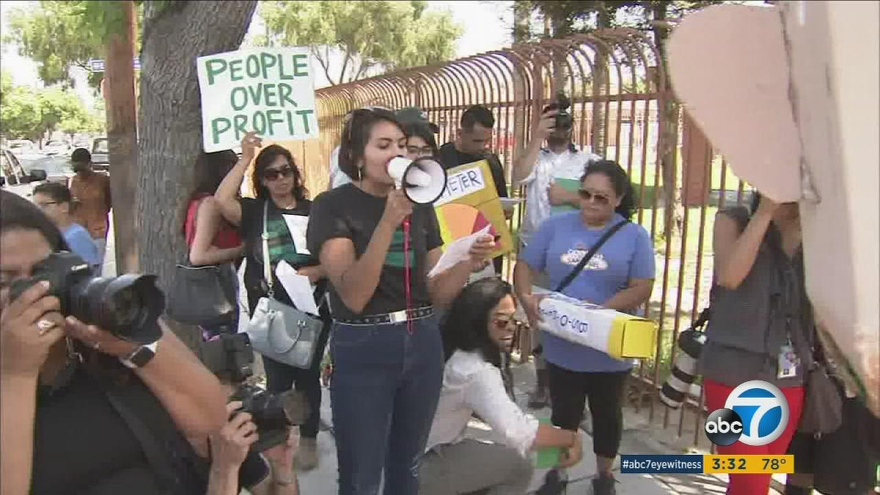 Protesters showed up to a bill signing ceremony that Gov. Jerry Brown was at in Bell Gardens, urging him to do more with clean air regulations.