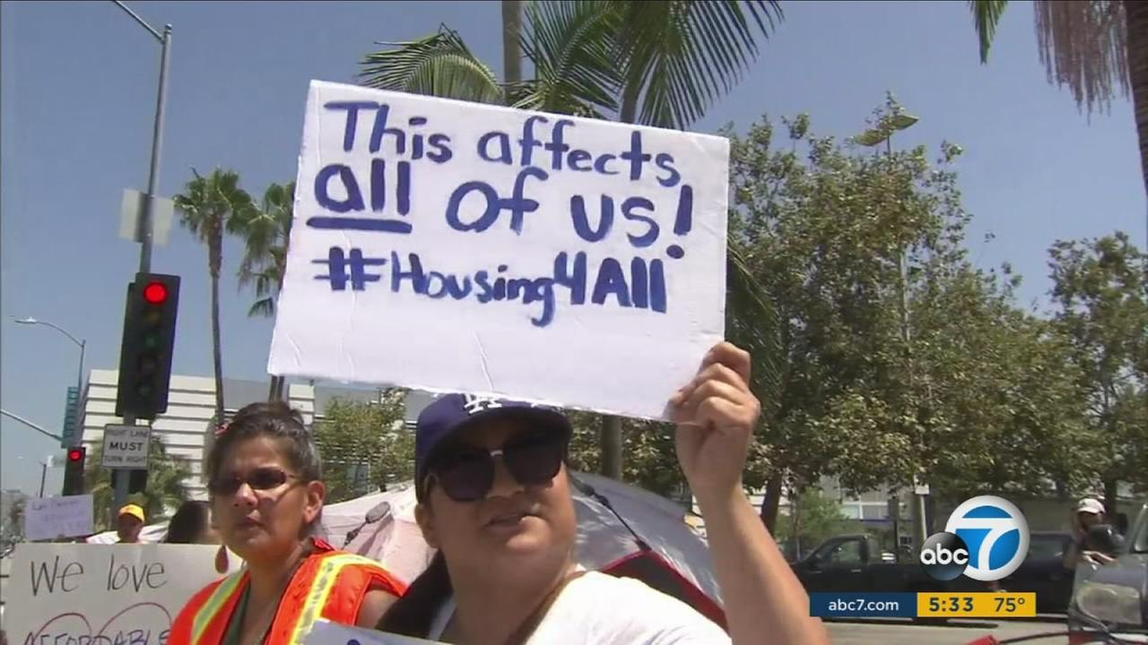 Activists erected a mock tent city outside the Grove shopping complex on Friday, July 28, 2017, while calling on city leaders to create more affordable housing in Los Angeles.