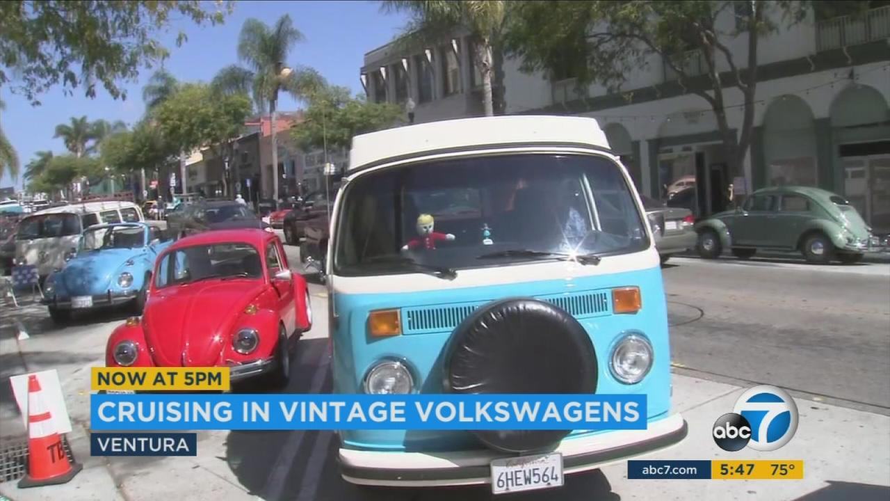 Vintage Volkswagen vehicles parked along downtown Ventura as part of an 11-day summer road trip along the West Coast toward the Mexico border.