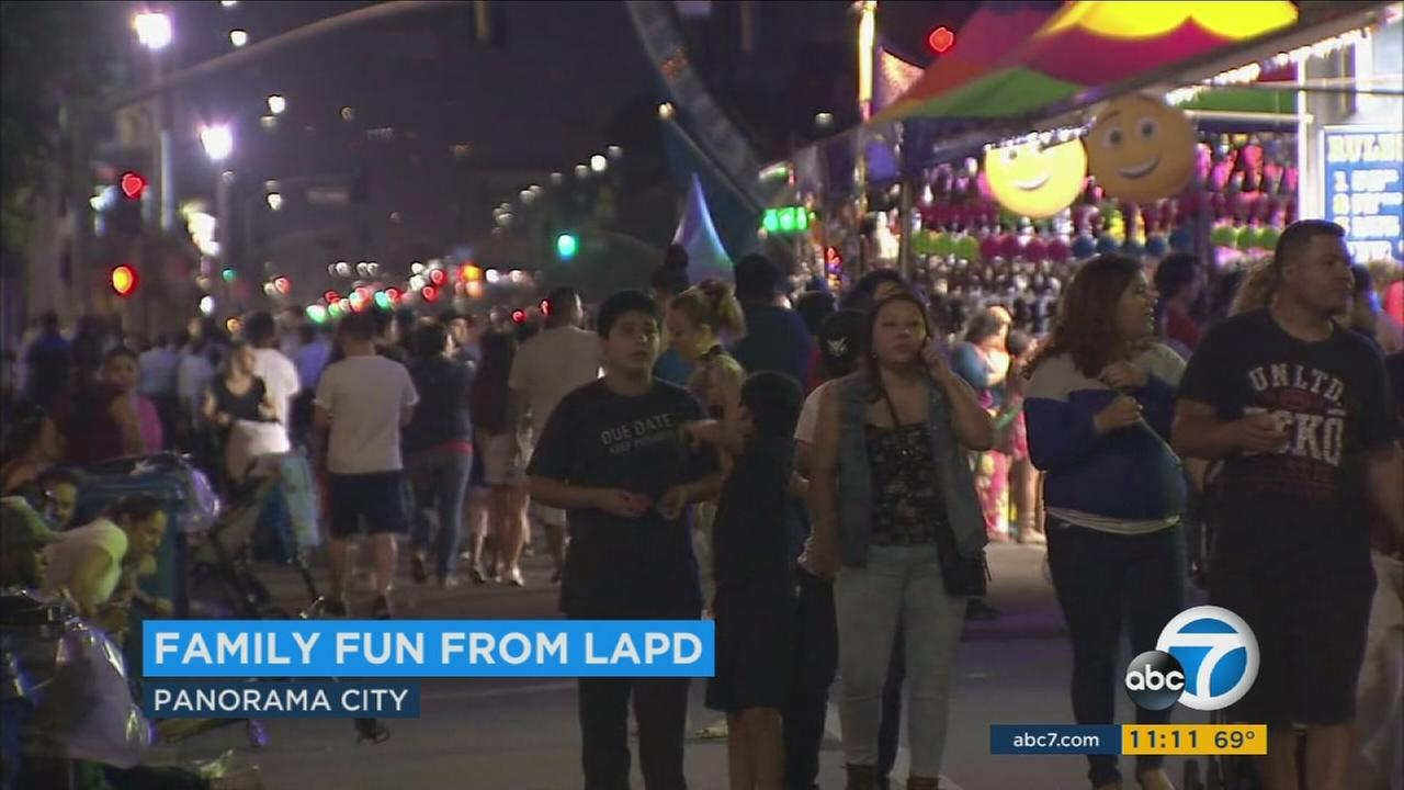 Hundreds of families and children wandered around a street carnival held by the LAPD Mission division.