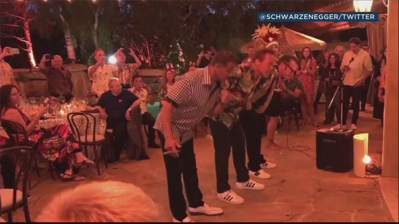 Arnold Schwarzenegger turned 70 and shared a video of him learning to hula with old friends Sylvester Stallone and Tom Arnold.