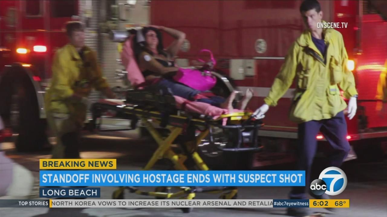 One of two victims is transported to a nearby hospital after a stabbing and hostage situation in Long Beach on Sunday, Aug. 7, 2017.