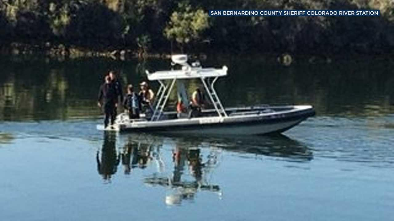 Sheriffs officials are seen near the scene of a fatal boating accident near the Big River Park on the Colorado River in San Bernardino County.