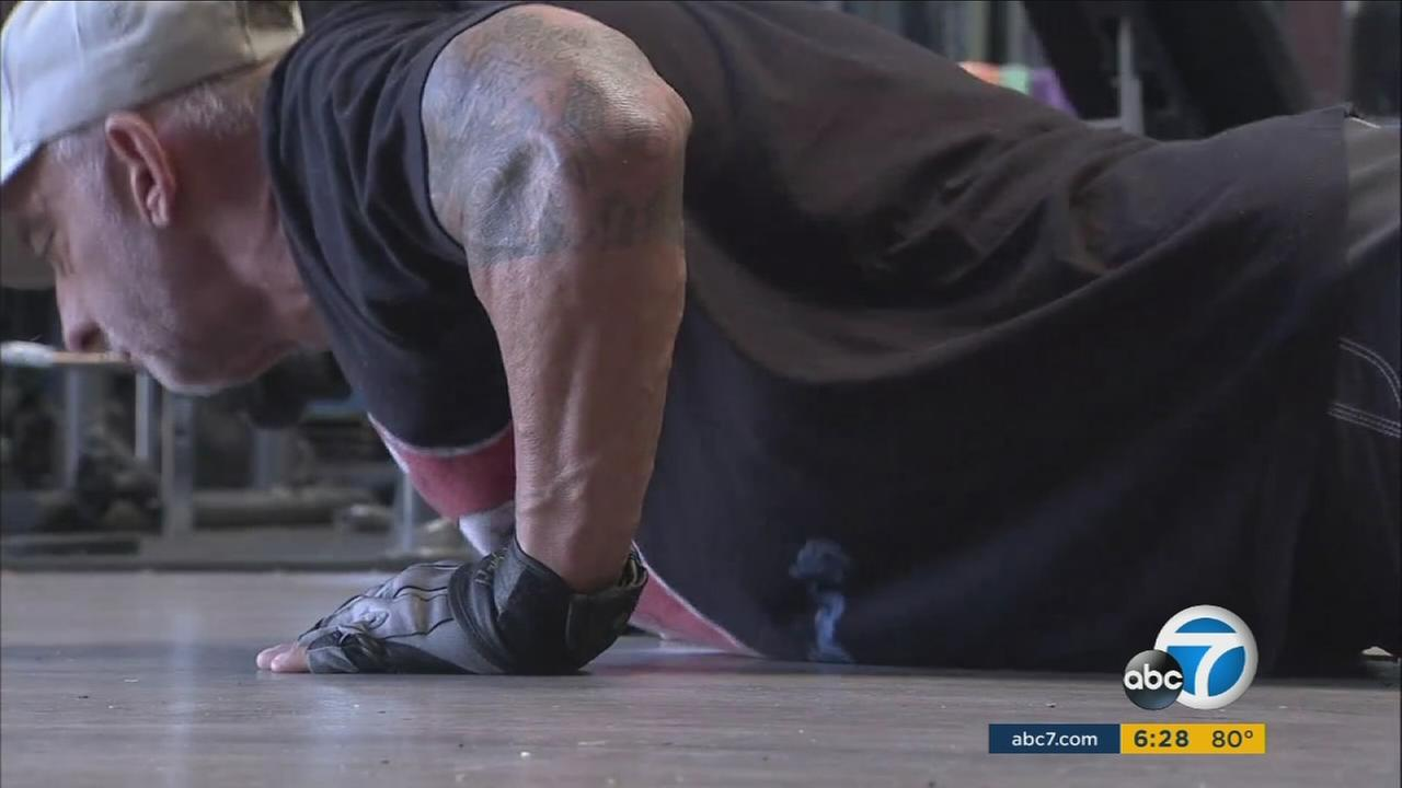 Jeff Myers is seen doing a push-up as he trains for an attempt to break several world records.