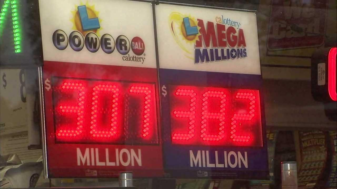 The jackpots for the Powerball and Mega Millions are seen lit up on the window of a 76 station in San Clemente on Wednesday, Aug. 9, 2017.