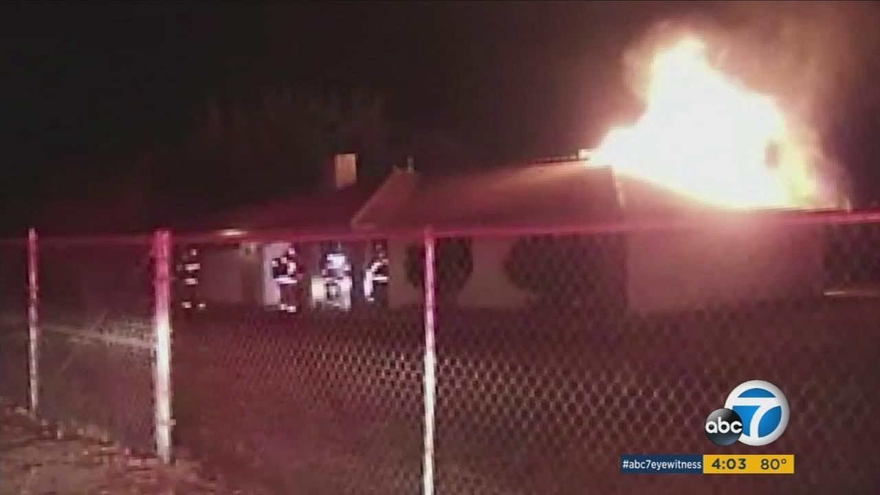 A photo shows footage of a house fire that a neighbor caught on cellphone video in Hesperia.