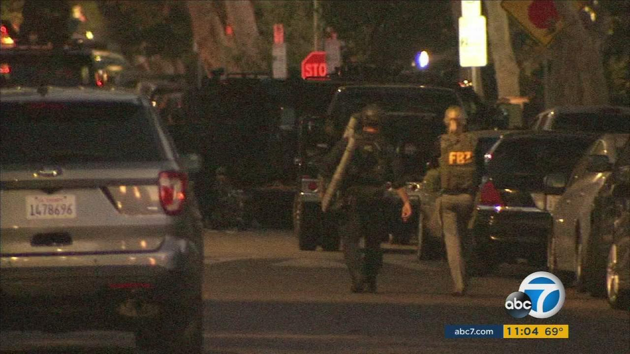 Authorities canvassed a neighborhood after an armed suspect barricaded himself inside a home in Beverly Grove on Wednesday, Aug. 9, 2017.