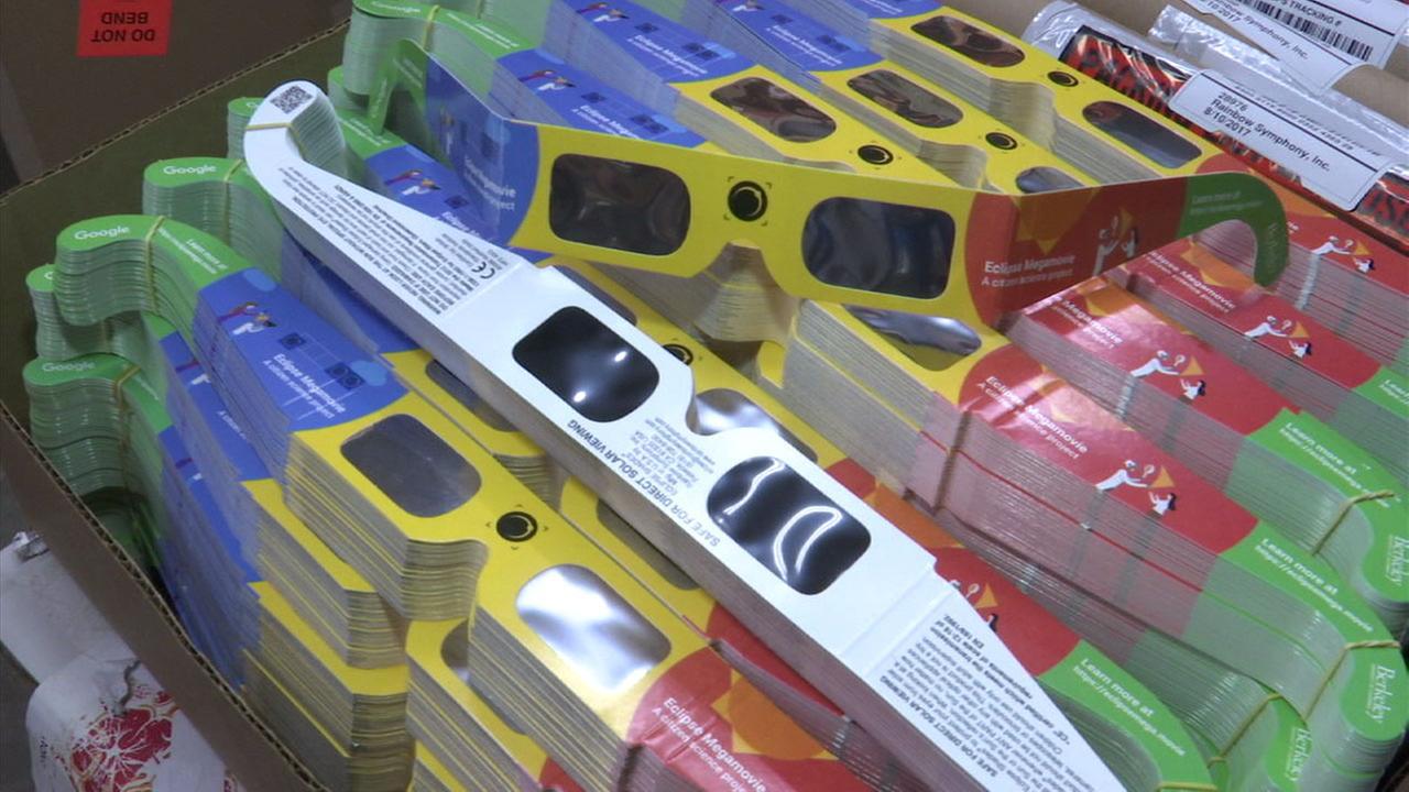 Legitimate solar eclipse glasses are shown in a photo.