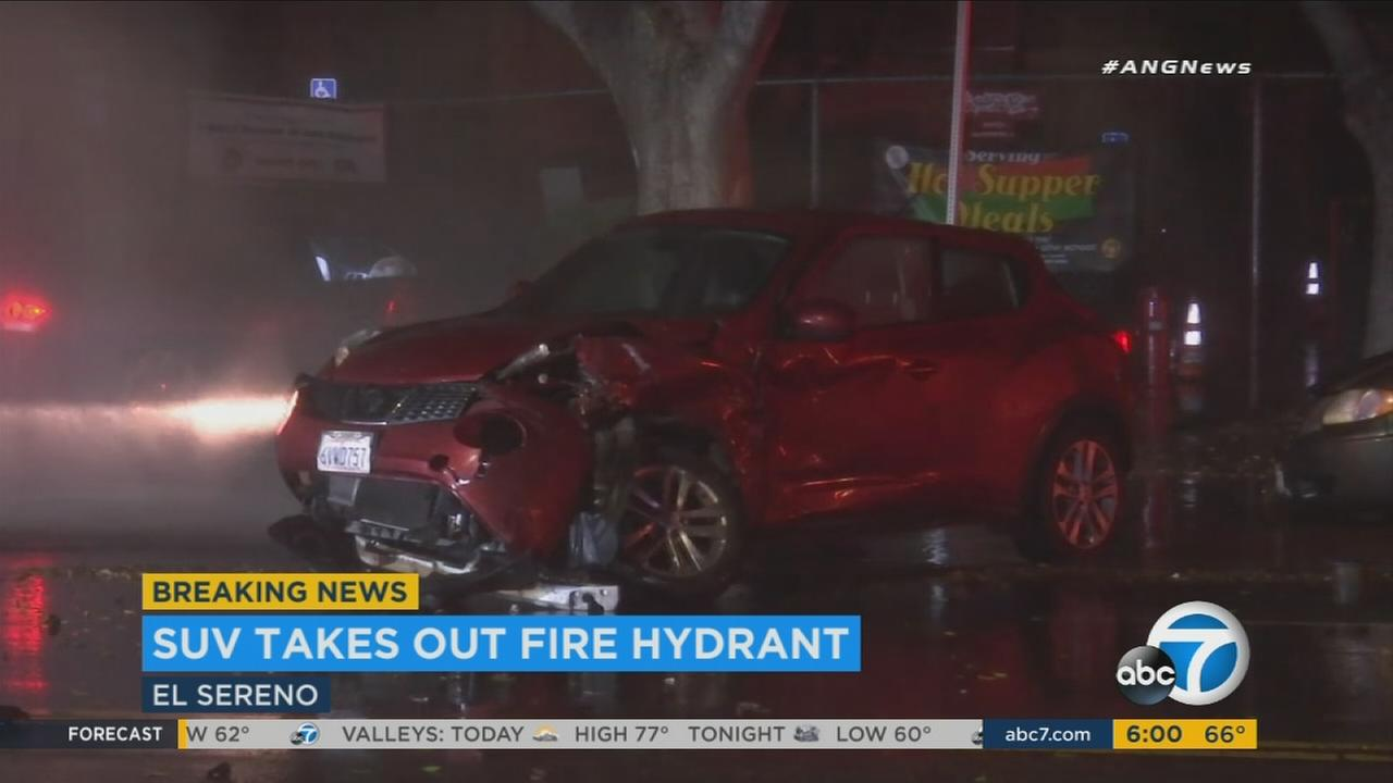 An SUV that took out power lines and sheared a fire hydrant, leading to an early morning power outage in El Sereno on Thursday, Aug. 17, 2017.