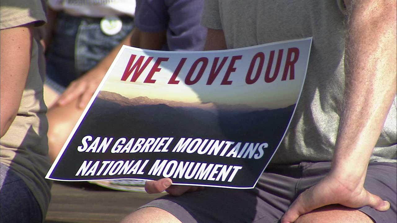 A sign reads, We love our San Gabriel Mountains National Monument.