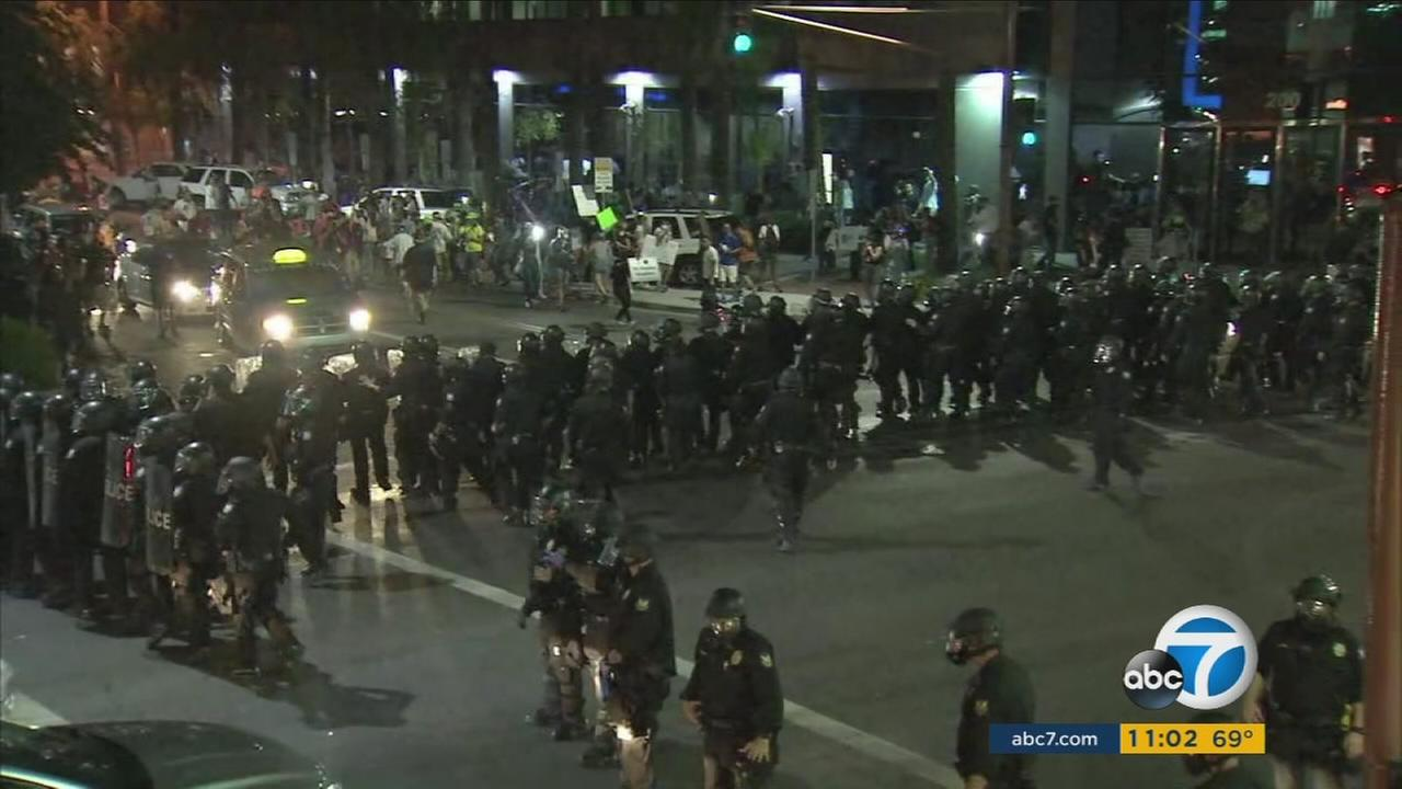 Trump protesters are seen being blocked by police in Phoenix, Arizona, after the president held a rally in the area on Tuesday, Aug. 22, 2017.