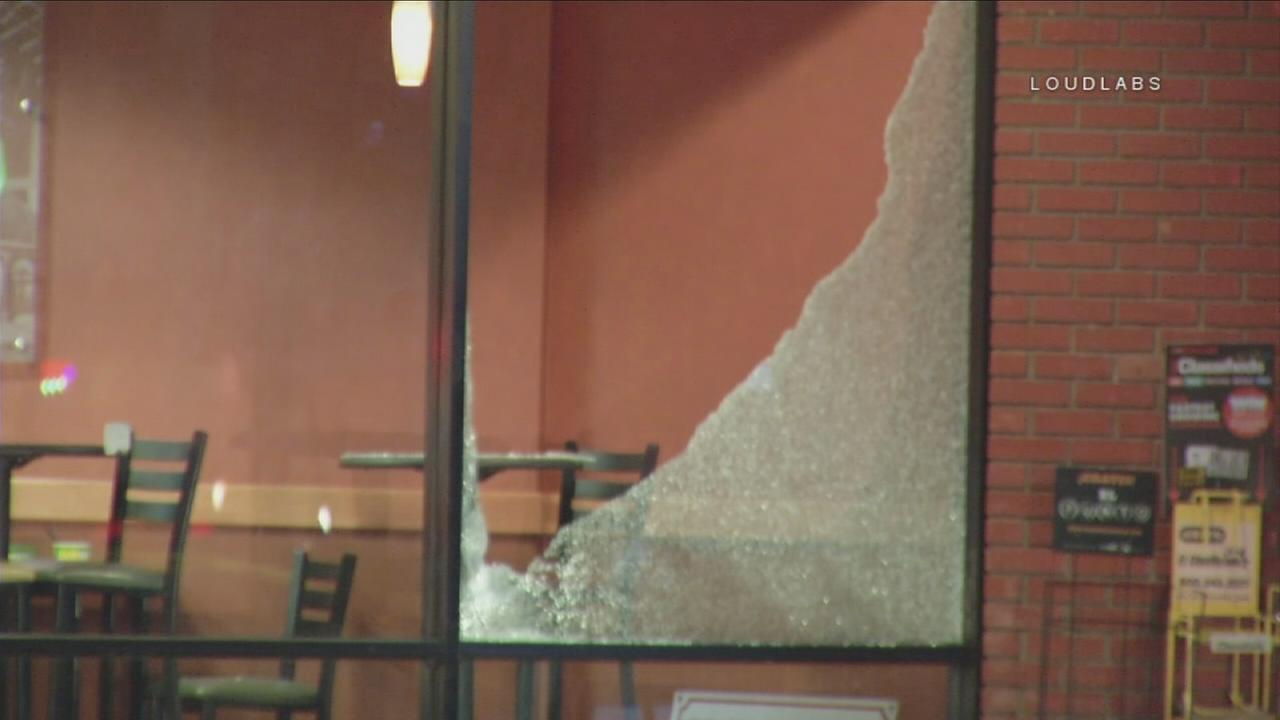 A shot out window is shown at a Subway on Venice Boulevard in Los Angeles after a suspect opened fire on the location on Wednesday, Aug. 24, 2017.