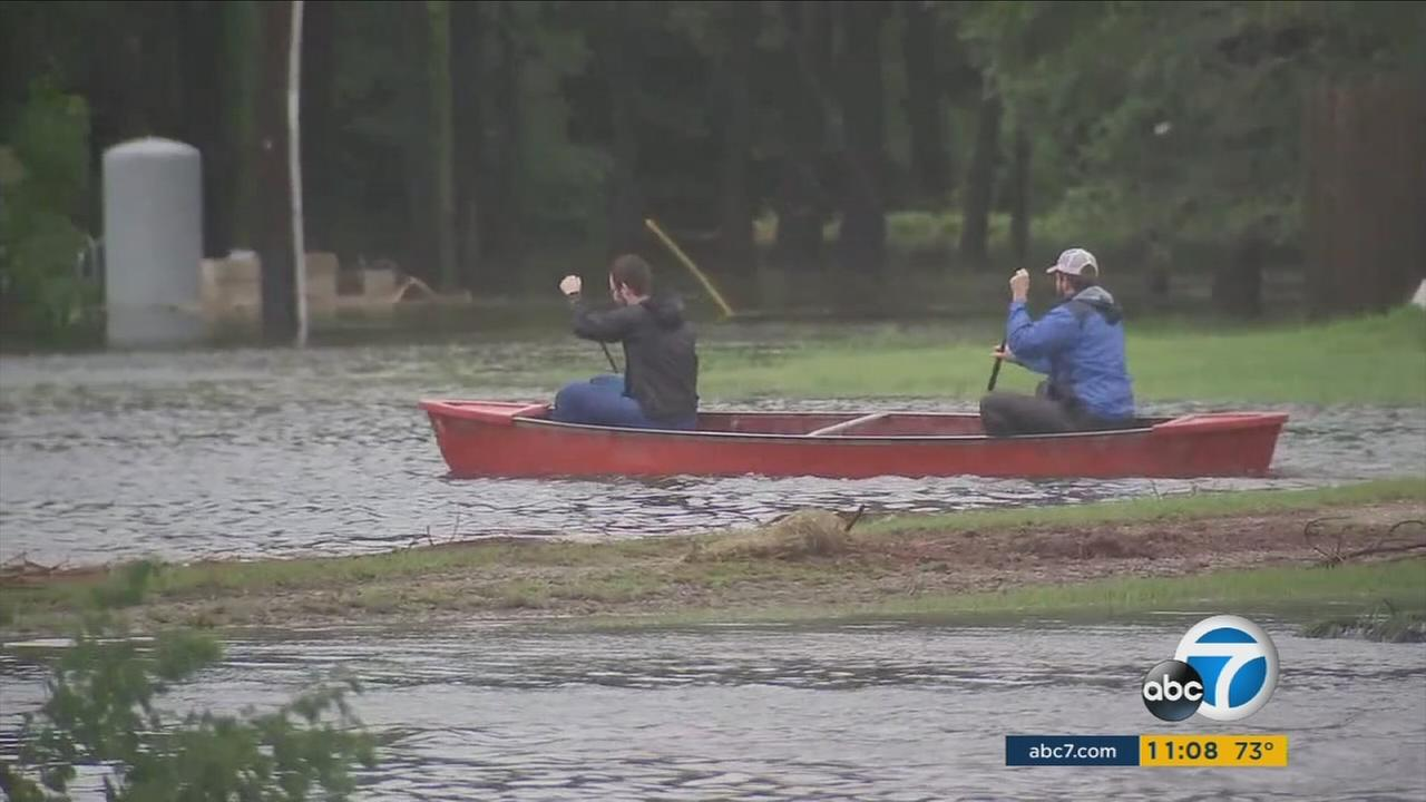 Two men went out in a canoe in an attempt to rescue people stranded in flood waters because of Hurricane Harvey in southeast Texas.