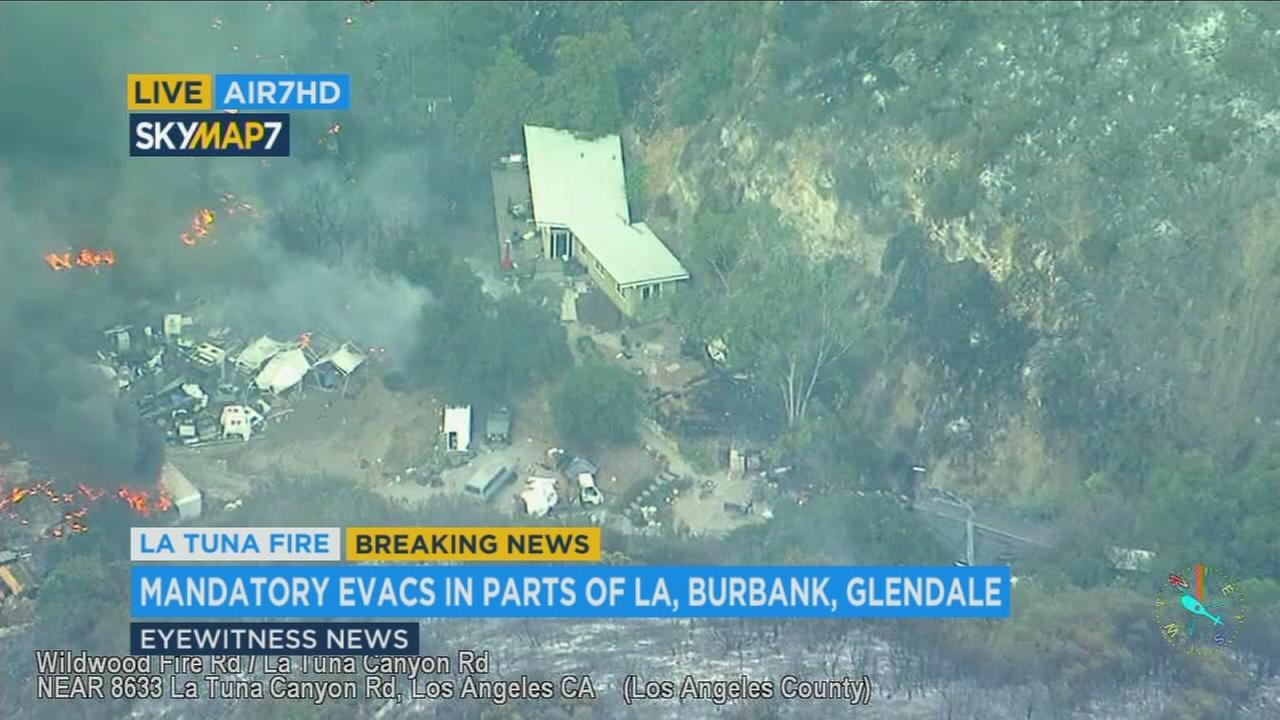 A man was seen at this home on La Tuna Canyon Road surrounded by flames.