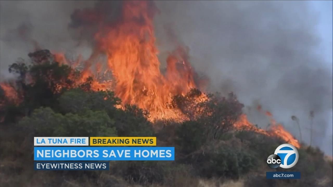 Flames on the hillside near the Shadow Hills neighborhood is shown.
