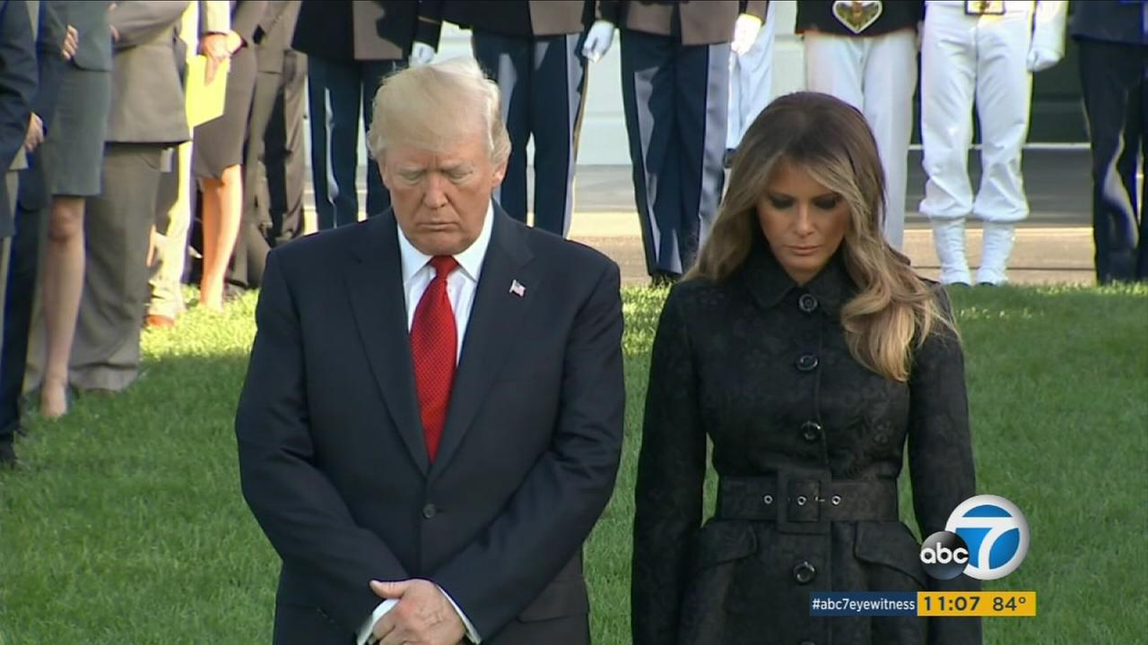 President Trump and first lady Melania Trump stand for a moment of silence during a ceremony to mark the anniversary of the Sept. 11 terrorist attacks, Monday, Sept. 11, 2017.