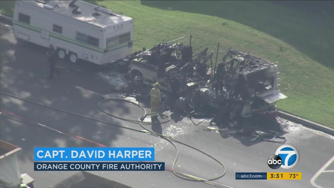 An RV erupted in flames in Santa Ana days after a naked woman had barricaded herself inside.
