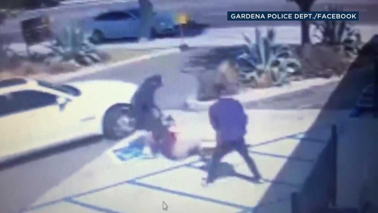 Two suspects are seen attacking a man in Gardena on Thursday, Sept. 7, 2017.
